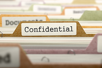 file folder labeled Confidential