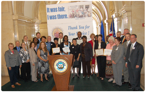 State and local court officials pose with a group of Milwaukee County jurors (holding certificates of appreciation), who gathered in the Milwaukee County Courthouse rotunda for a juror appreciation event on Sept. 4. Among officials making remarks at the ceremony: Wisconsin Supreme Court Chief Justice Shirley S. Abrahamson; Chief Judge Kitty K. Brennan, Milwaukee County Circuit Court (now a Court of Appeals judge); Milwaukee County Clerk of Circuit Court John Barrett; and State Bar of Wisconsin President Diane Diel.